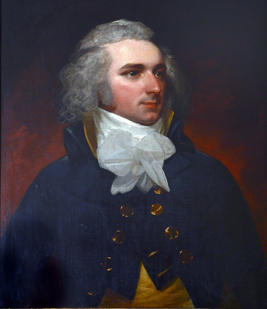 Half-length, wearing a blue jacket over a buff waistcoat and white cravat. Oil on canvas 30 ins by 25 ins