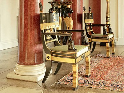Pair of ebonised and gilt chairs from the Thomas Hope suite