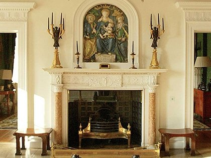 The chimney-piece with its della Robbia glazed ceramic panel
